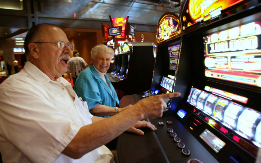An Old Man Is Playing Slots